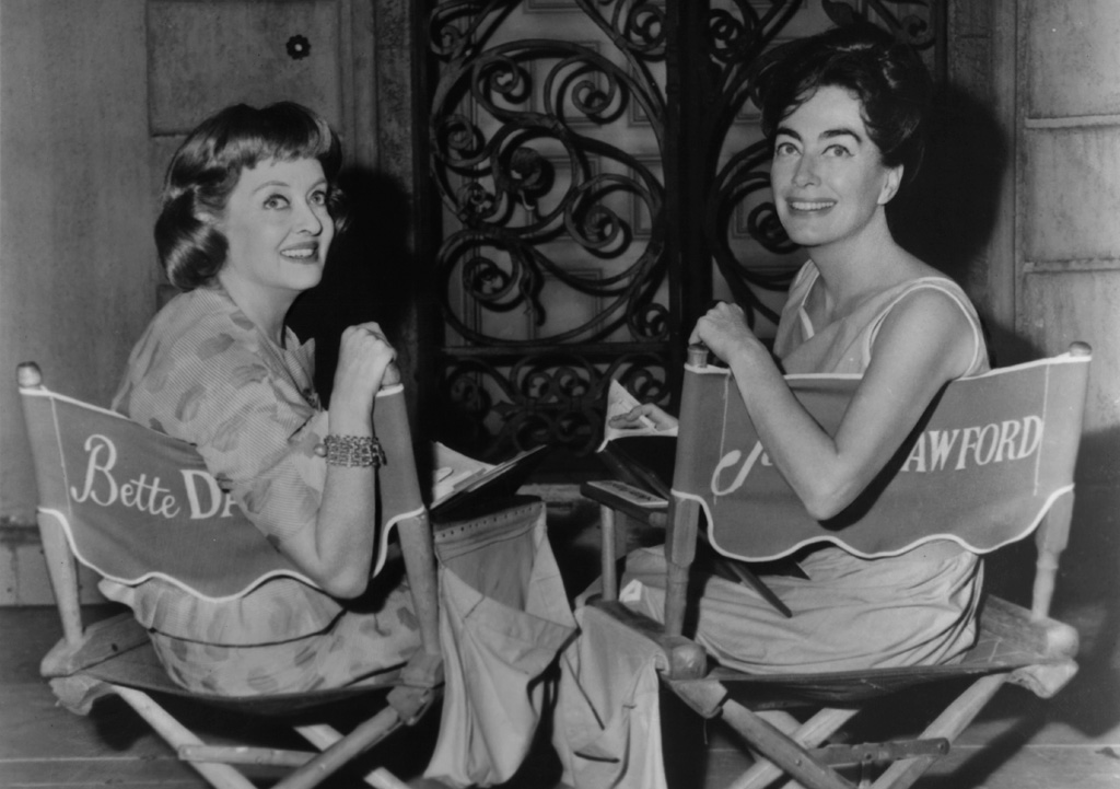 Bette Davis and Joan Crawford in between scenes from the film 'What Ever Happened To Baby Jane?', 1962. (Photo by Warner Brothers/Getty Images)