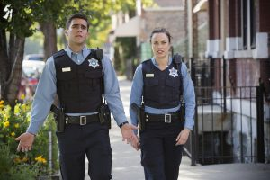 "SIRENS -- ""Superdick"" Episode 201 -- Pictured: (l-r) Josh Segarra as Billy, Jessica McNamee as Theresa Kelly -- (Photo by: Chuck Hodes/USA Network)"