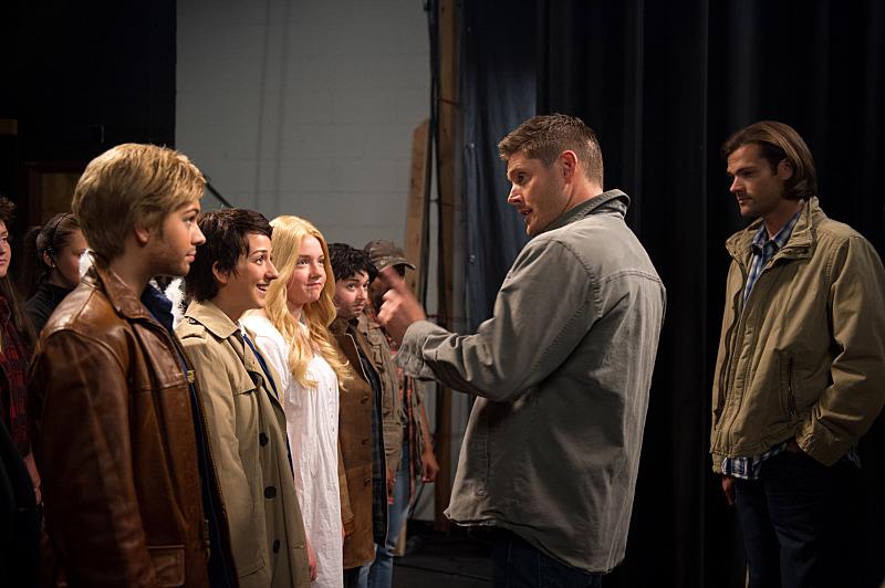"Supernatural -- ""Fan Fiction"" -- Image SN1005d_0063 -- Pictured (L-R): Alyssa Lynch as Shiobhan (""Dean""), Nina Winkler as Kristen (""Castiel""), Rachel Warkentin as Tammy (""Mary""), Kelli Ogmundson as Alice (""John""), Vivien Elizabeth as Katie (""Bobby""), Jensen Ackles as Dean, and Jared Padalecki as Sam -- Credit: Diyah Pera/The CW -- © 2014 The CW Network, LLC. All Rights Reserved"